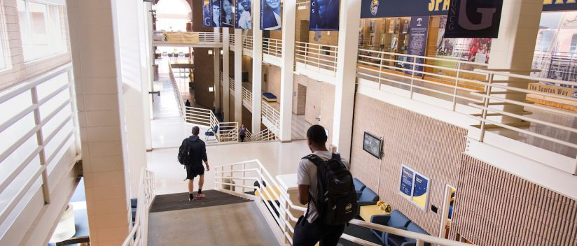 UNCG students walk through the Mary Channing Coleman Building on Thursday April, 21 2016. (Tigermoth Creative/Chris English)