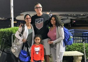 Myriam Villalobos with her two daughters and Casey Smith