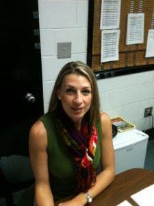 Marcia Rosiek sitting at her desk.