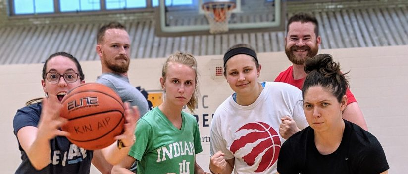 Students Posing with a basketball making silly serious faces